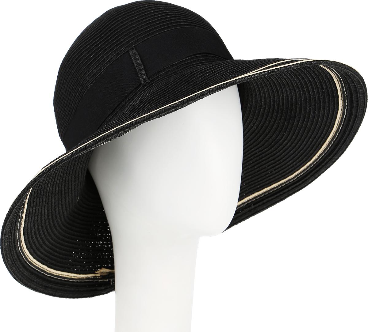 Шляпа женская Canoe Chic, цвет: черный. 1966191. Размер 561966191Очаровательная женская шляпа Canoe Chic, выполненная из искусственной соломы и прочного полиэстера, станет незаменимым аксессуаром для пляжа и отдыха на природе. Широкие поля шляпы обеспечат надежную защиту от солнечных лучей.Шляпа оформлена декоративной лентой с бантом. Плетение шляпы обеспечивает необходимую вентиляцию и комфорт даже в самый знойный день. Шляпа легко восстанавливает свою форму после сжатия.Стильная шляпа с элегантными волнистыми полями подчеркнет вашу неповторимость и дополнит ваш повседневный образ.