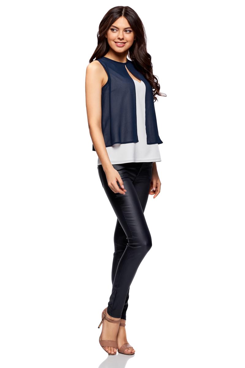 Блузка женская oodji Ultra, цвет: белый, темно-синий. 11401263/26546/1279B. Размер 40-170 (46-170)11401263/26546/1279BСтильная женская блузка, выполненная из 100% полиэстера, отлично дополнит ваш гардероб. Модель без рукавов выполнена в виде блузки и накидки.