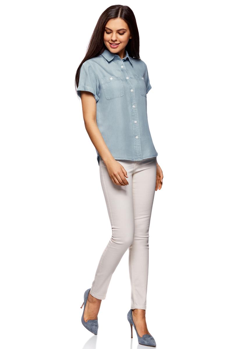 Рубашка женская oodji Ultra, цвет: голубой джинс. 16A09004/45490/7000W. Размер 42-170 (48-170)16A09004/45490/7000WСтильная рубашка oodji Ultra выполнена из легкого материала, имитирующего джинс. Модель прямого кроя с отложным воротничком и короткими рукавами застегивается на пуговицы по всей длине и дополнена двумя накладными карманами с пуговицами. Рубашка отлично подойдет для офиса, прогулок и дружеских встреч и будет отлично сочетаться с джинсами и брюками. Мягкая ткань на основе вискозы приятна на ощупь и комфортна в носке.