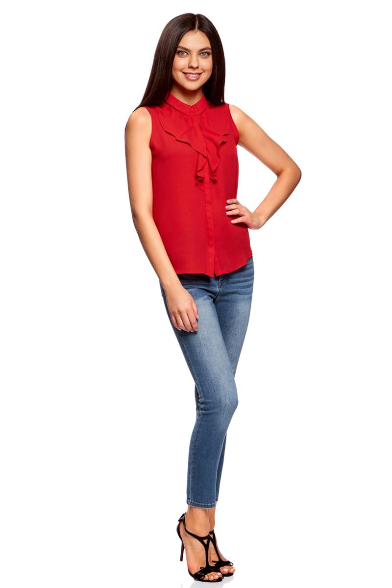 Блузка женская oodji Collection, цвет: красный. 21411108/36215/4500N. Размер 42-170 (48-170)21411108/36215/4500NЛаконичная женская блуза oodji Collection выполнена из струящегося материала и оформлена воланами. Модель прямого кроя с отложным воротничком застегивается по всей длине на пуговицы, скрытые планкой. Блуза подойдет для офиса, прогулок и дружеских встреч и будет отлично сочетаться с джинсами и брюками, а также гармонично смотреться с юбками. Мягкая ткань на основе полиэстера приятна на ощупь и комфортна в носке.