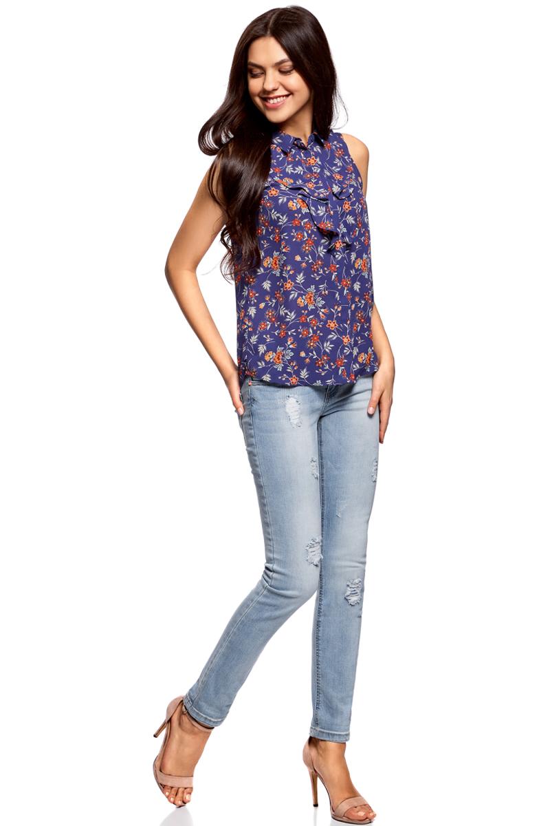 Блузка женская oodji Collection, цвет: темно-синий, оранжевый, цветы. 21411108/36215/7955F. Размер 36-170 (42-170)21411108/36215/7955FЛаконичная женская блуза oodji Collection выполнена из струящегося материала и оформлена воланами. Модель прямого кроя с отложным воротничком застегивается по всей длине на пуговицы, скрытые планкой. Блуза подойдет для офиса, прогулок и дружеских встреч и будет отлично сочетаться с джинсами и брюками, а также гармонично смотреться с юбками. Мягкая ткань на основе полиэстера приятна на ощупь и комфортна в носке.
