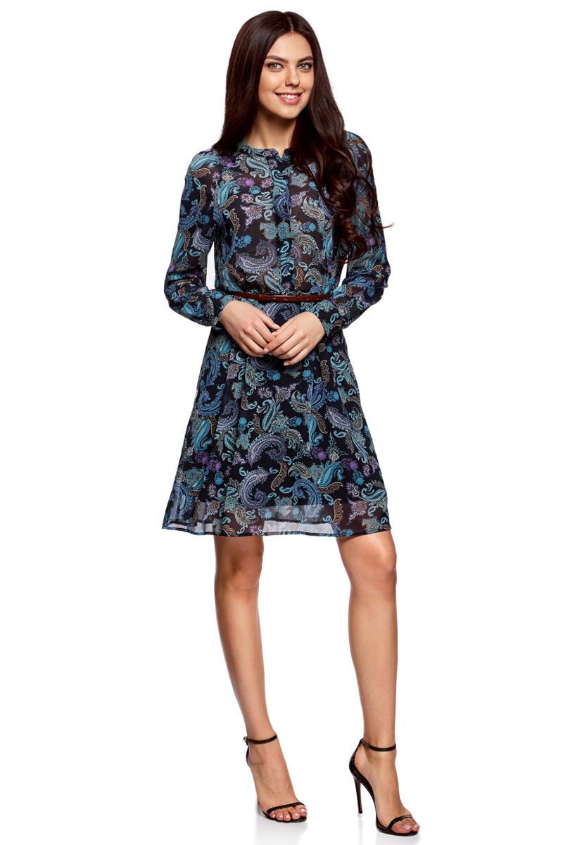 Платье oodji Collection, цвет: темно-синий, бирюзовый. 21912001-1M/38375/7973E. Размер 36-170 (42-170)21912001-1M/38375/7973EПлатье oodji Collection полуприлегающего кроя выполнено из шифона и оформлено ярким принтом. Модель средней длины с круглым вырезом горловины и длинными рукавами-реглан застегивается спереди и на манжетах на пуговицы; сбоку имеется скрытая застежка-молния. Платье подойдет для офиса, прогулок и дружеских встреч и станет отличным дополнением гардероба в летний период. Мягкая ткань на основе полиэстера приятна на ощупь и комфортна в носке.В комплект с платьемвходит узкий ремень из искусственной кожи с металлической пряжкой.