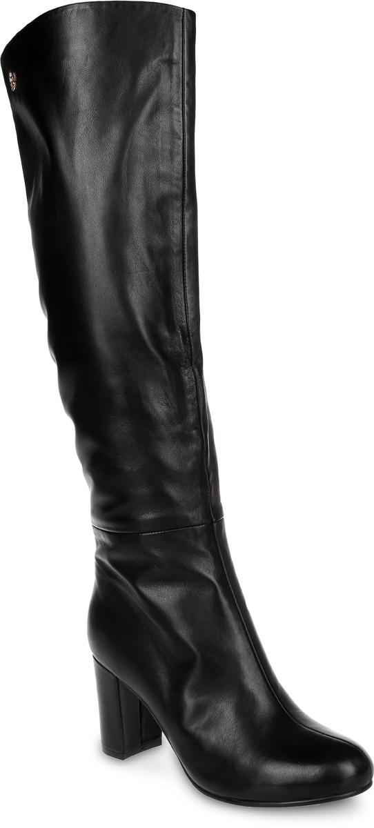 Сапоги женские Graciana, цвет: черный. T5075-1-2. Размер 37T5075-1-2Женские сапоги от Graciana на устойчивом каблуке выполнены из натуральной кожи. Подкладка и стелька, изготовленные из байки, обладают хорошей влаговпитываемостью и естественной воздухопроницаемостью. Подошва из полимерного термопластичного материала обеспечивает хорошую амортизацию и сцепление с любой поверхностью.