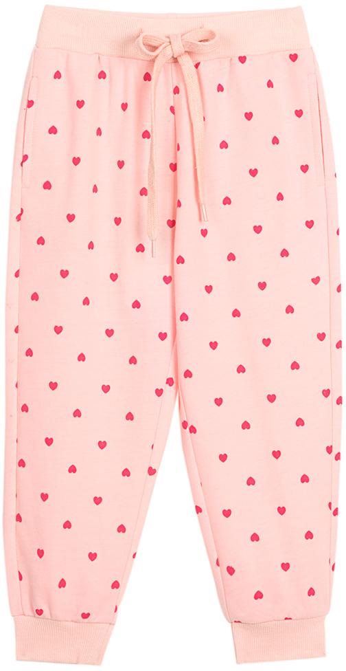 Брюки для девочки Vitacci, цвет: розовый. 2172127-11. Размер 1102172127-11Удобные трикотажные брюки свободного кроя - отличная модель для отдыха на природе и занятий спортом.