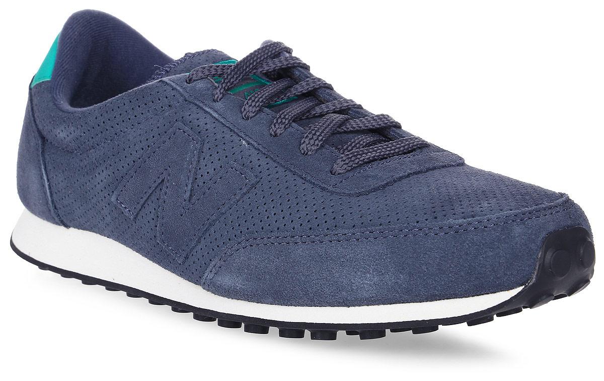 Кроссовки мужские New Balance 410, цвет: синий. U410PB/D. Размер 8 (41,5)U410PB/DСтильные мужские кроссовки от New Balance придутся вам по душе. Верх модели выполнен из полиэстера и натуральной замши, и дополнен перфорацией. По бокам обувь оформлена декоративными элементами в виде фирменного логотипа бренда, на язычке - фирменной нашивкой, задник логотипом бренда. Классическая шнуровка надежно зафиксирует изделие на ноге. Подкладка и стелька, изготовленные из текстиля, гарантируют уют и предотвращают натирание. Подошва оснащена рифлением для лучшей сцепки с поверхностями. Удобные кроссовки займут достойное место среди коллекции вашей обуви.