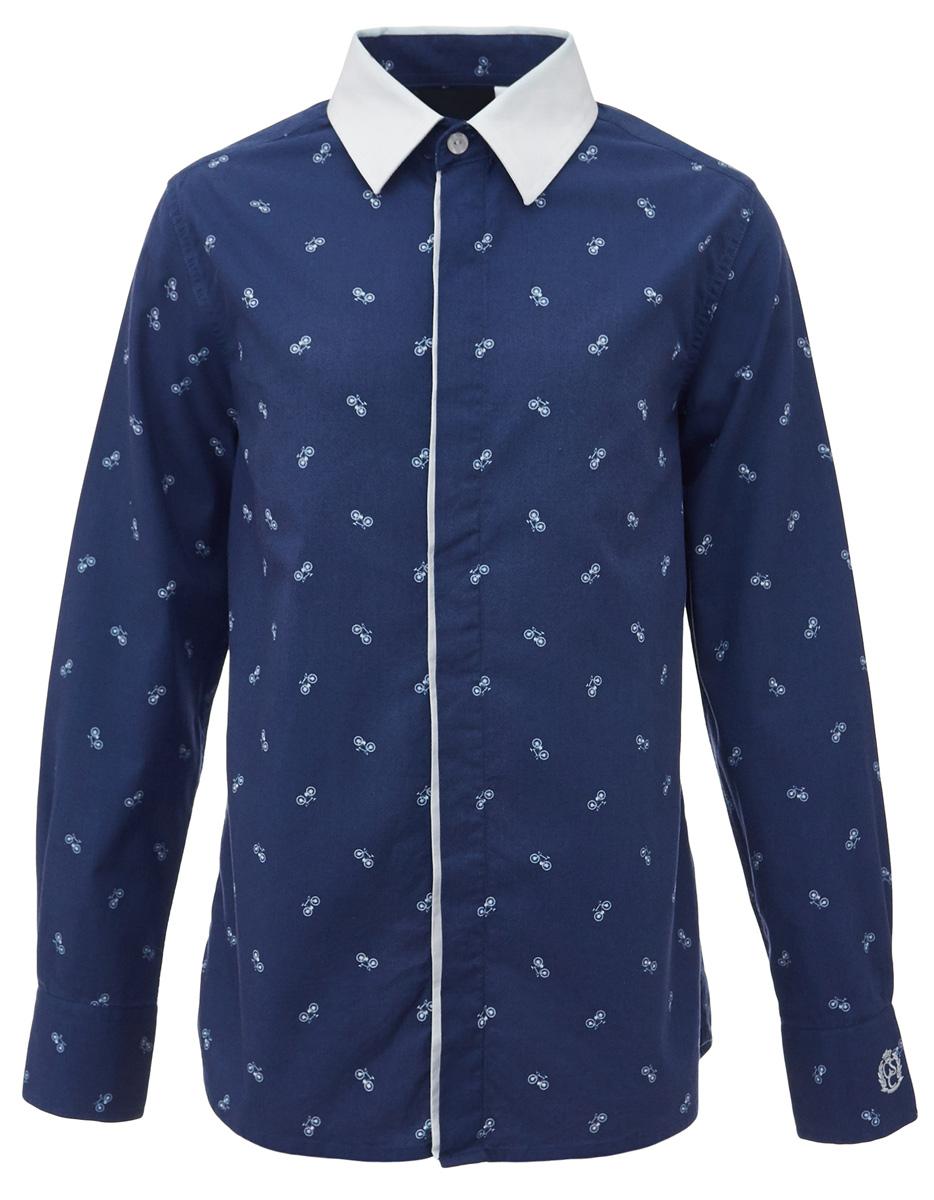 Рубашка для мальчика Gulliver, цвет: синий. 217GSBC2311. Размер 140217GSBC2311При всем богатстве выбора, купить рубашку для мальчика высокого качества не очень просто. Школьная рубашка должна отлично выглядеть, хорошо сидеть, соответствовать актуальной форме, быть всегда свежей, выглаженной и опрятной. Именно поэтому состав, плотность и текстура материала имеют большое значение! Рубашка с мелким рисунком - тренд сезона! Она не нарушает школьный дресс-код, но делает повседневный Look ярче и интереснее, создавая позитивное настроение. Контрастная отделка суппатной планки, белый воротник и деликатная фирменная вышивка на манжете придают модели выразительность и индивидуальность.