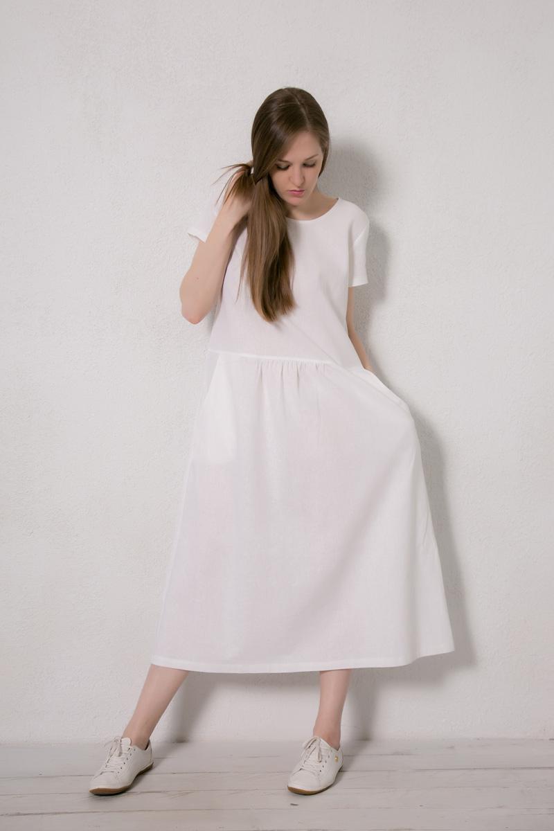 Платье домашнее Marusя, цвет: белый. 171223. Размер 52171223Домашнее платье Marusя изготовлено из натурального льна. Изделие длины макси свободного кроя с короткими рукавами. Модель дополнена карманами.