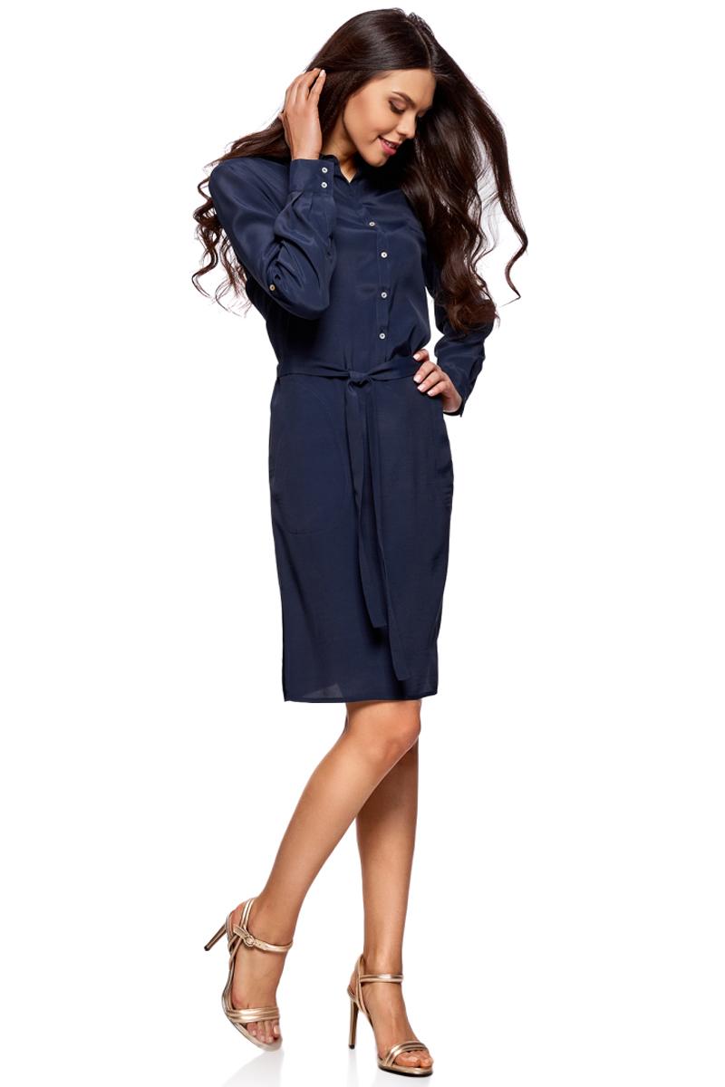 Платье oodji Collection, цвет: темно-синий. 21911022/42800/7900N. Размер 38-170 (44-170)21911022/42800/7900NПлатье-рубашка от oodji выполнено из натуральной вискозы. Модель с длинными рукавами, карманами и отложным воротником застегивается на пуговицы. На талии платье дополнено текстильным поясом.