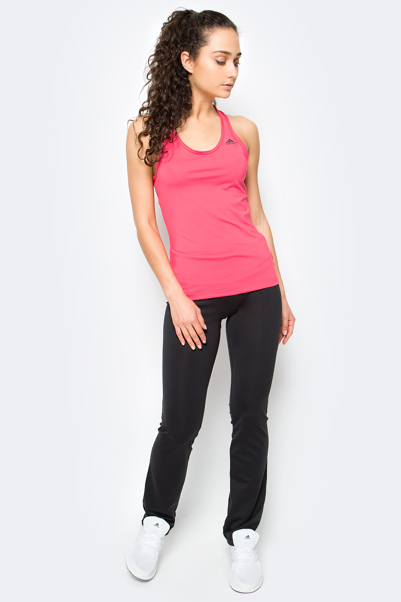 Майка женская Adidas D2m Tank Solid, цвет: розовый. BK2660. Размер XL (52/54)BK2660Спортивная женская майка D2m Tank Solid для энергичных тренировок, где требуется максимальная свобода движений. Модель из ткани с технологией climalite эффективно отводит излишки влаги, сохраняя свежесть. Майка имеет приталенный крой, борцовые лямки на спине, глубокий круглый ворот и логотип adidas вверху слева.