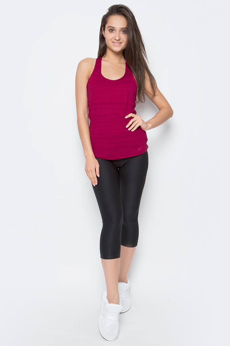 Тайтсы женские Nike Dry Cpri Ti Poly, цвет: черный. 802948-010. Размер XS (40/42)802948-010Тайтсы Dry Cpri Ti Poly от Nike выполнены из эластичного материал Dri-FIT, отводящего влагу с поверхности тела. Облегающий крой и завышенный эластичный пояс обеспечат идеальную посадку. Модель имеет внутренний карман на поясе и плоские швы.