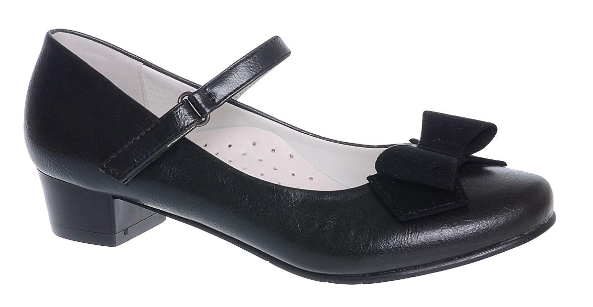Туфли для девочки Болеро, цвет: черный. D13350. Размер 36D13350Очаровательные туфли для девочки Болеро станут неотъемлемой частью повседневной жизни юной модницы.Модель выполнена из высококачественной искусственной кожи и оформлена замшевым бантиком. Внутренняя отделка выполнена из натуральной кожи. Удобная застежка-липучка быстро и надежно фиксирует обувь на ноге ребенка, а формованный задник обеспечивает правильную установку стопы внутри туфель, предотвращая развитие деформаций.Стелька с супинатором, изготовленная из натуральной кожи, учитывает анатомические особенности строения детской стопы, обеспечивает профилактику от развития плоскостопия и гарантирует ногам ребенка ощущение комфорта и легкости при ходьбе.Рифленая подошва с каблучком из легкого полимерного термопластичного материала обладает высокой прочностью и гибкостью и обеспечивает надежное сцепление с различными поверхностями.