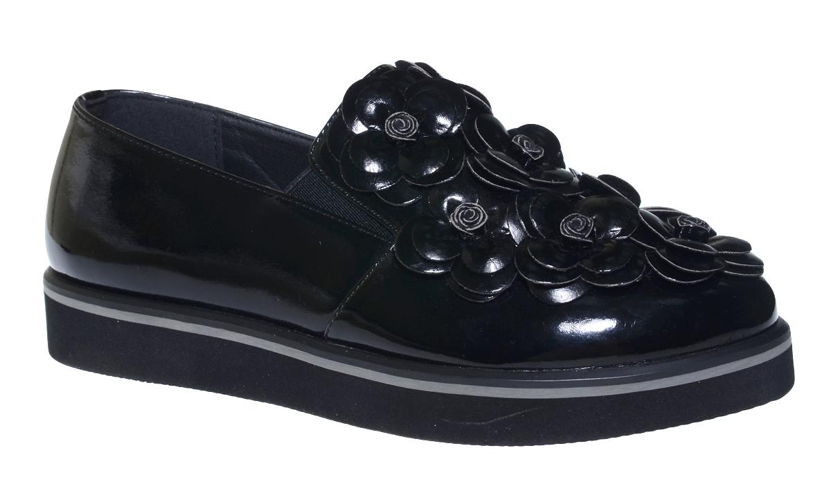 Туфли для девочки Болеро, цвет: черный. D13399A. Размер 34D13399AОчаровательные туфли для девочки Болеро станут неотъемлемой частью повседневной жизни юной модницы.Модель выполнена из искусственной лакированной кожи и оформлена объемными цветами. Внутренняя отделка выполнена из натуральной кожи. Небольшие резинки на подъеме надежно фиксируют обувь на ноге ребенка, а формованный задник обеспечивает правильную установку стопы внутри туфель, предотвращая развитие деформаций.Стелька с супинатором, изготовленная из натуральной кожи, учитывает анатомические особенности строения детской стопы, обеспечивает профилактику от развития плоскостопия и гарантирует ногам ребенка ощущение комфорта и легкости при ходьбе.Толстая рифленая подошва из легкого полимерного термопластичного материала обладает высокой прочностью и гибкостью и обеспечивает надежное сцепление с различными поверхностями.
