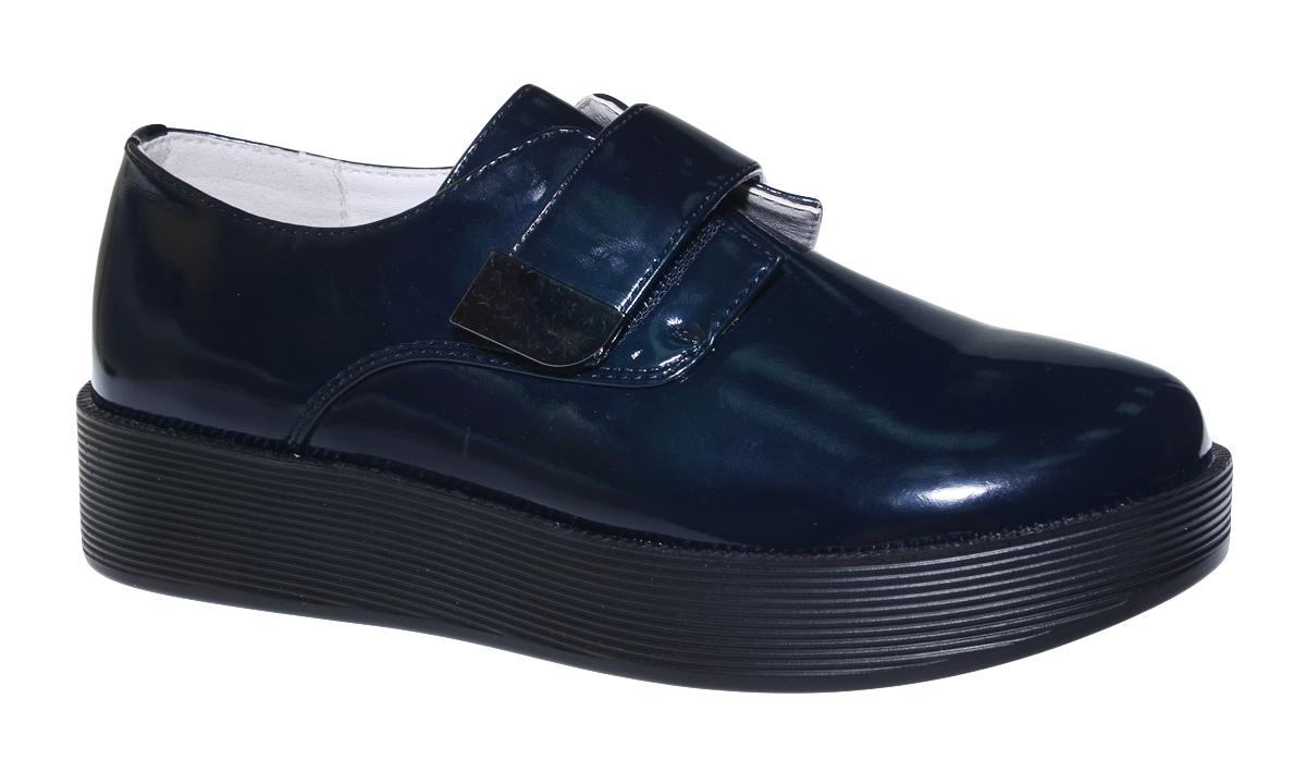 Полуботинки для девочки Болеро, цвет: темно-синий. D13400A. Размер 34D13400AСтильные полуботинки для девочки Болеро станут неотъемлемой частью повседневной жизни юной модницы.Модель выполнена из искусственной лакированной кожи. Внутренняя отделка выполнена из натуральной кожи. Удобная застежка-липучка быстро и надежно фиксирует обувь на ноге ребенка, а формованный задник обеспечивает правильную установку стопы внутри модели, предотвращая развитие деформаций.Стелька с супинатором, изготовленная из натуральной кожи, учитывает анатомические особенности строения детской стопы, обеспечивает профилактику от развития плоскостопия и гарантирует ногам ребенка ощущение комфорта и легкости при ходьбе.Небольшая рифленая платформа из легкого полимерного термопластичного материала обладает высокой прочностью и гибкостью и обеспечивает надежное сцепление с различными поверхностями.