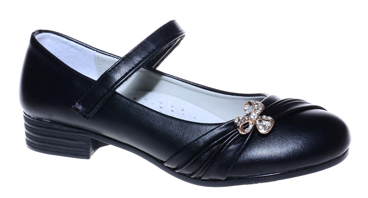 Туфли для девочки Мифер, цвет: черный. 7216M-1. Размер 317216M-1Прелестные туфли от бренда Мифер придутся по душе вашей юной моднице! Модель изготовлена из гладкой искусственной кожи и на мысе оформлена декоративными складками и бантиком со стразами. Ремешок с застежкой-липучкой отвечает за надежную фиксацию модели на ноге. Внутренняя поверхность из натуральной кожи не натирает. Стелька из кожи дарит комфорт при носке. Подошва с рифлением обеспечивает идеальное сцепление с любыми поверхностями. Стильные туфли - незаменимая вещь в гардеробе каждой девочки.