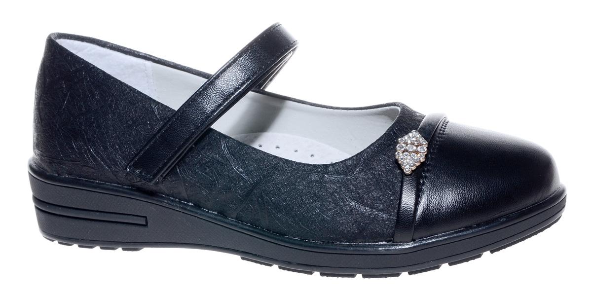 Туфли для девочки Мифер, цвет: черный. 7217D-1. Размер 337217D-1Прелестные туфли от бренда Мифер придутся по душе вашей юной моднице! Модель изготовлена из искусственной кожи и оформлена декоративным тиснением и стильной фурнитурой со стразами. Ремешок с застежкой-липучкой отвечает за надежную фиксацию модели на ноге. Внутренняя поверхность из натуральной кожи не натирает. Стелька из кожи дарит комфорт при носке. Подошва с рифлением обеспечивает идеальное сцепление с любыми поверхностями. Стильные туфли - незаменимая вещь в гардеробе каждой девочки.