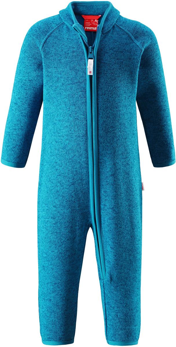 Комбинезон флисовый детский Reima Tahti, цвет: синий. 5163206490. Размер 865163206490Легкий и мягкий флисовый комбинезон, поддетый под верхнюю одежду, согреет малышей в морозные зимние дни, но при этом его можно носить и в помещении! Этот флисовый комбинезон для малышей снабжен молнией во всю длину, чтобы облегчить процесс надевания, и защитой для подбородка, которая не даст поцарапать шею и подбородок. Он сшит из мягкого и очень популярного меланжевого вязаного флиса, который объединил в себе стильный вязаный дизайн и все преимущества флиса: теплый и приятный на ощупь флис быстро сохнет, выводя влагу в верхние слои одежды – идеальный выбор для активных прогулок и веселых приключений на свежем воздухе!