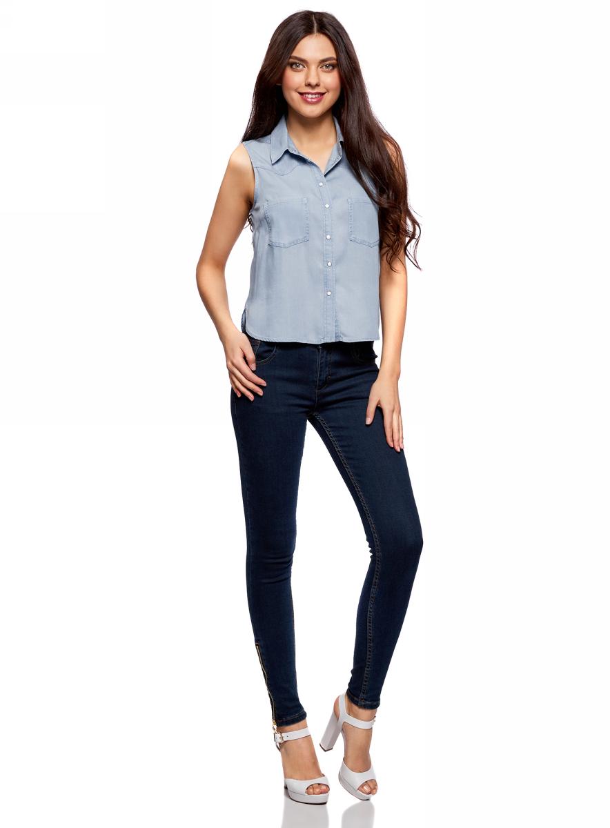 Блузка женская oodji Ultra, цвет: голубой джинс. 19009007/42579/7000W. Размер 40-170 (46-170)19009007/42579/7000WЖенская блузка от oodji выполнена из лиоцелла. Модель без рукавов и отложным воротником застегивается на кнопки, на груди дополнена накладными карманами.