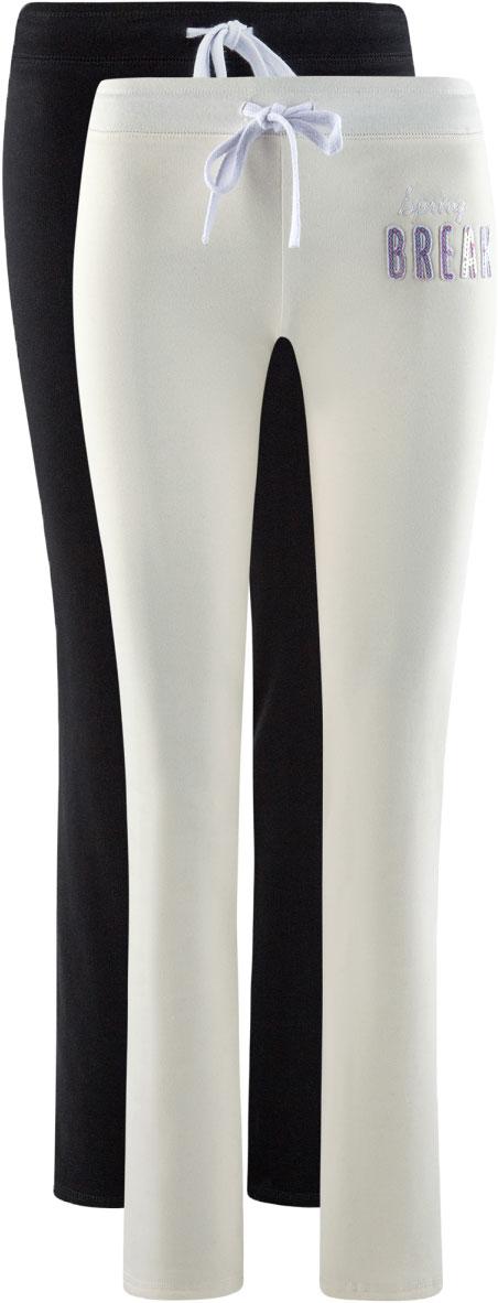 Брюки спортивные женские oodji Ultra, цвет: белый, черный, 2 шт. 16700045T2/46949/1229N. Размер XS (42)16700045T2/46949/1229NЖенские спортивные брюки от oodji, выполненные из натурального хлопка, великолепно подойдут для отдыха и занятий спортом. Модель дополнена широкой эластичной резинкой на поясе. Объем талии регулируется с внешней стороны при помощи шнурка-кулиски. В комплект входят две пары брюк.