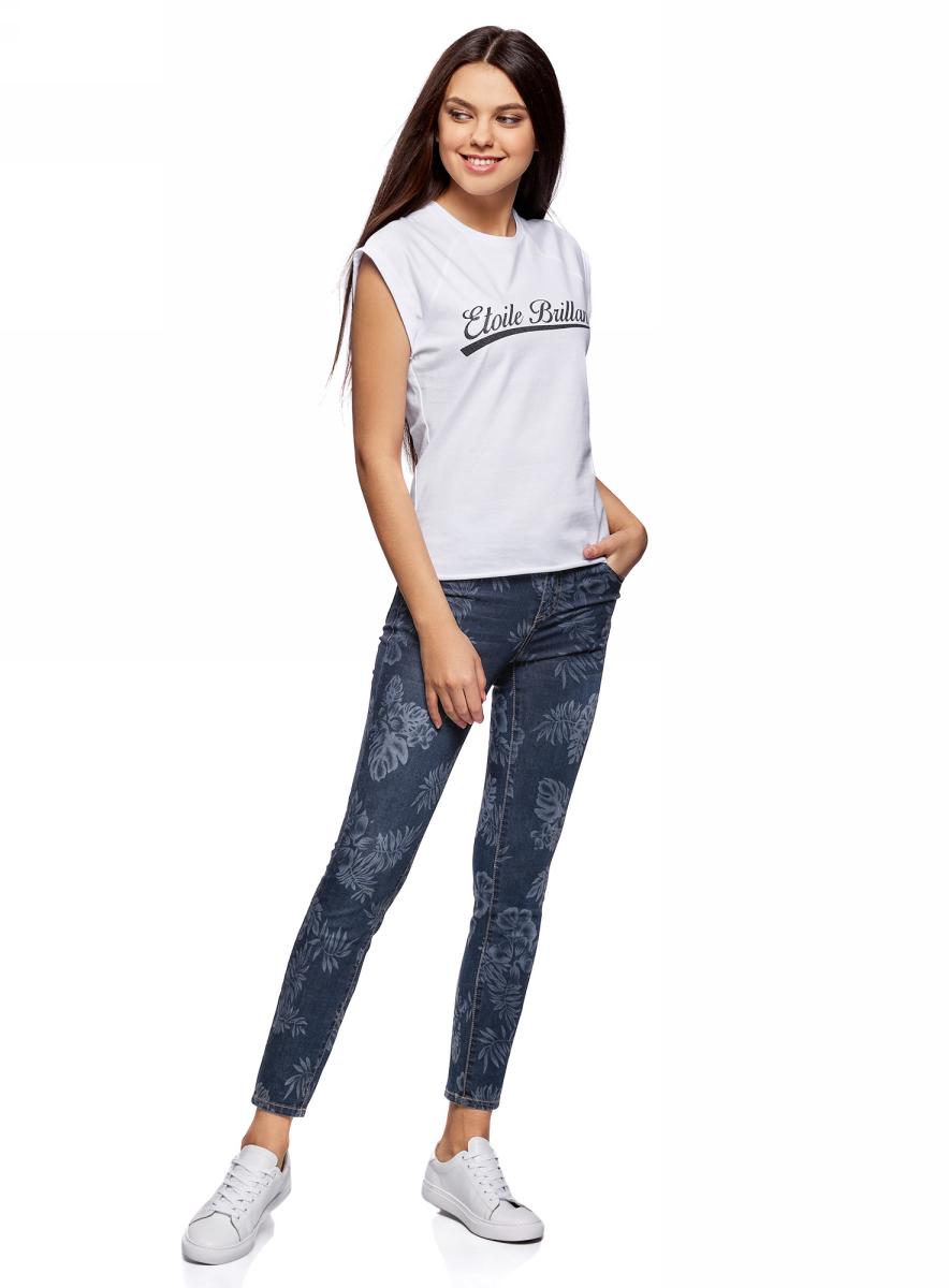 Джинсы женские oodji Ultra, цвет: темно-синий джинс. 12106147/46810/7900W. Размер 28-30 (46-30)12106147/46810/7900WЖенские джинсы-скинни oodji выполнены из высококачественного материала на основе хлопка. Укороченные джинсы застегиваются на пуговицу в поясе и ширинку на застежке-молнии, дополнены шлевками для ремня. Спереди модель дополнена двумя втачными карманами, одним маленьким накладным, а сзади - двумя накладными карманами. Изделие оформлено оригинальным принтом.