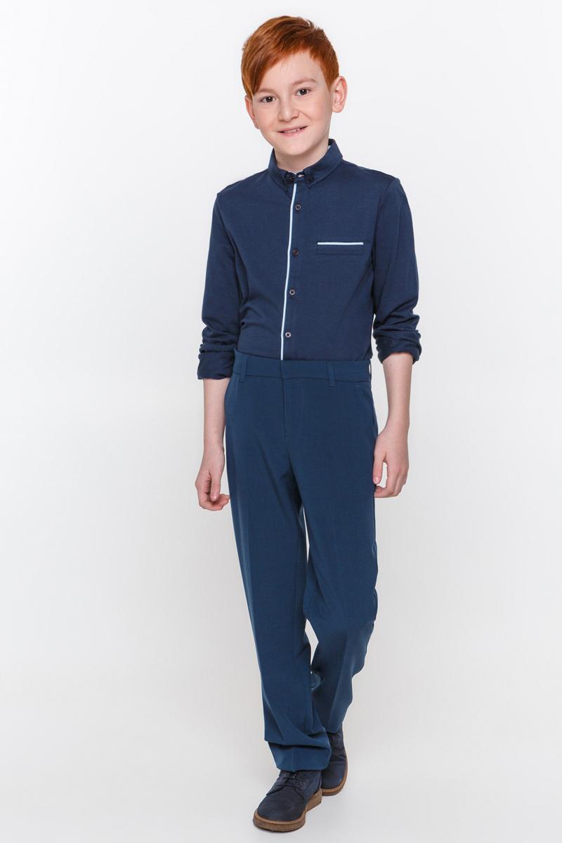 Рубашка для мальчика Overmoon Gesper, цвет: темно-синий. 21100100002_600. Размер 14021100100002_600Рубашка для мальчика Overmoon выполнена из высококачественного материала. Модель с отложным воротником и длинными рукавами застегивается по всей длине на пуговицы.