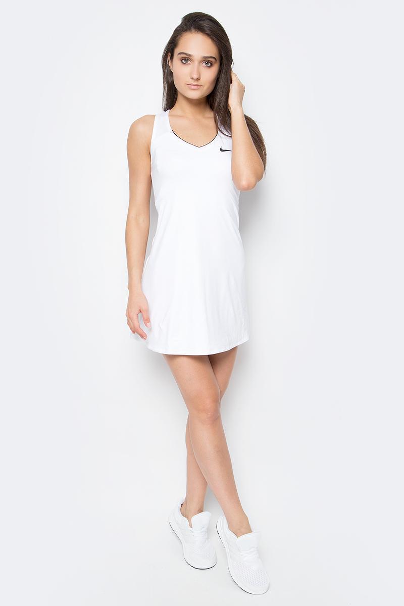 Платье для тенниса Nike Pure Dress, цвет: белый. 728736-100. Размер M (44/46)728736-100Теннисное платье Pure Dress от Nike выполнено из мягкого трикотажа. Ткань с технологией Dri-Fit выводит влагу на поверхность, откуда она испаряется, обеспечивая сухость и комфорт. Технология Stay Cool создает приятную прохладу во время интенсивных тренировок. Модель расклешенного крой с V-образным вырезом горловины имеет плоские швы.