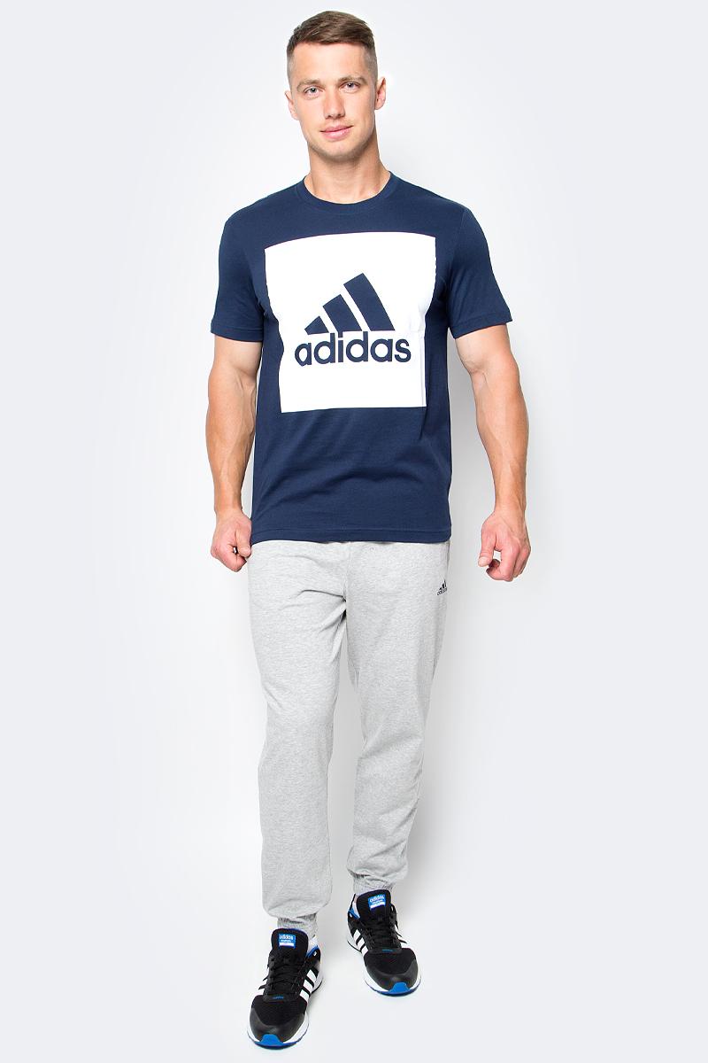 Футболка мужская adidas Ess Biglogo Tee, цвет: темно-синий, белый. S98726. Размер XXL (60/62)S98726Мужская футболка adidas Ess Biglogo Tee выполнена из натурального хлопка. Классический крой обеспечивает оптимальную свободу движений. Модель украшена большим принтом с фирменным логотипом adidas на груди. Крой реглан на задней стороне рукавов для большей свободы движений.