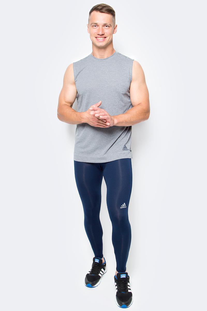 Тайтсы мужские Adidas Tf Base Tight, цвет: темно-синий. AJ5209. Размер M (48/50)AJ5209Тренировки в холодную погоду требую держать ваши мышцы в тепле. Данная модель поддерживает ваши мышцы по всей длине ноги, технология climalite выводит лишнюю влагу для большего комфорта во время тренировок.
