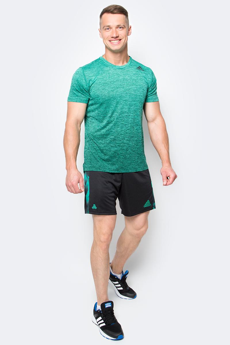 Шорты для футбола мужские Adidas Tango Cage, цвет: черный. BK3739. Размер L (52/54)BK3739Комфортные шорты для футболиста Adidas Tango Cage, уверенно ведущего свою команду к победе. Матч на улице или в коробке — в них удобно в любом случае. Модель сшита из быстросохнущего материала. Ткань с технологией climalite быстро и эффективно отводит влагу с поверхности кожи.Эластичный пояс на регулируемых завязках-шнурках.Графические принты по бокам.Логотип Tango на правом бедре.