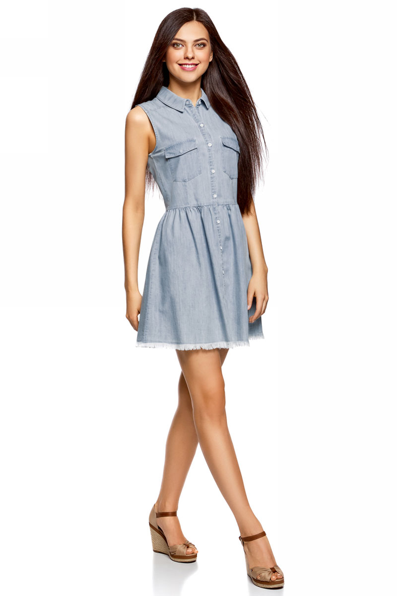 Платье oodji Ultra, цвет: голубой. 12909054/46789/7000W. Размер 40-170 (46-170)12909054/46789/7000WСтильное платье oodji изготовлено из качественного плотного материала. Модель с отложным воротничком и без рукавов застегивается на пуговицы, спереди имеются накладные карманы. Нижняя часть оформлена складками, подол отделан бахромой.