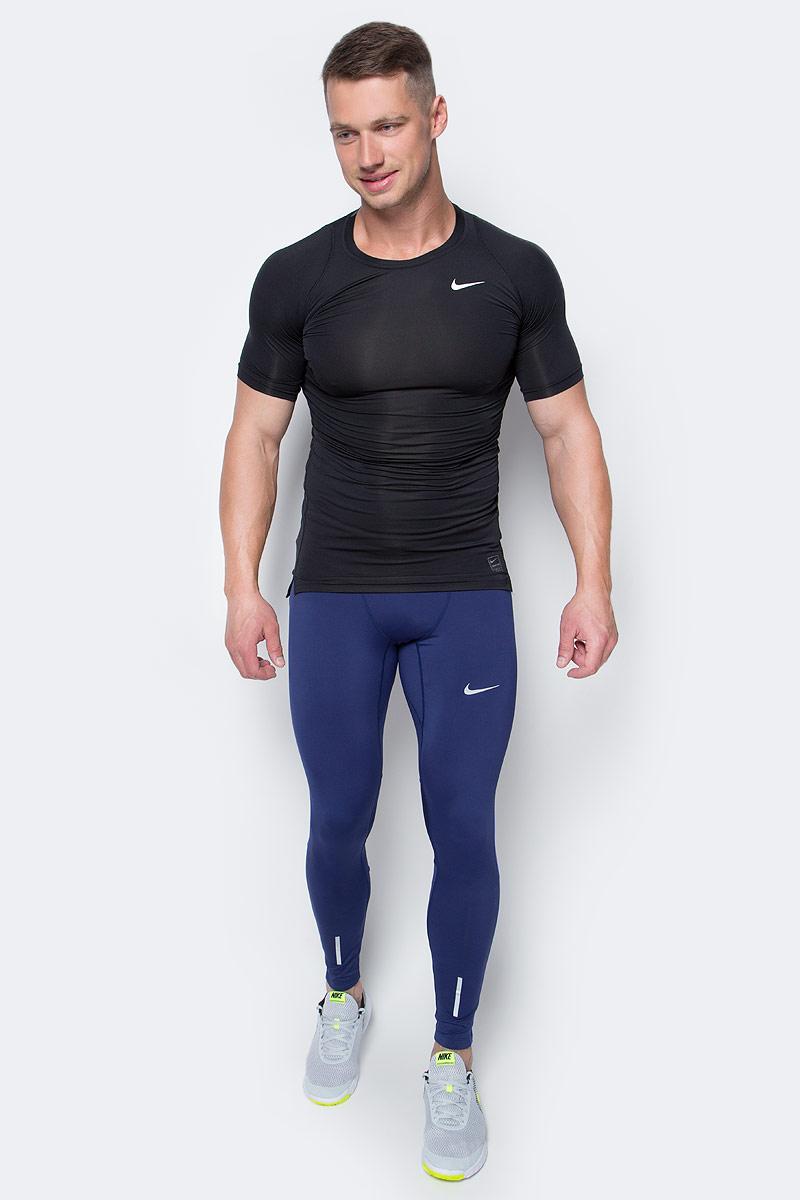 Тайтсы мужские Nike Tech Tights, цвет: синий. 642827-429. Размер XXL (54/56)642827-429Мужские тайтсы от Nike выполнены из эластичного полиэстера. Эластичная ткань Nike Power обеспечивает компрессионную посадку и поддержку. Вставки из сетки под коленями обеспечивают вентиляцию в зоне повышенного тепловыделения, застежки-молнии внизу позволяют быстро снимать и надевать модель.