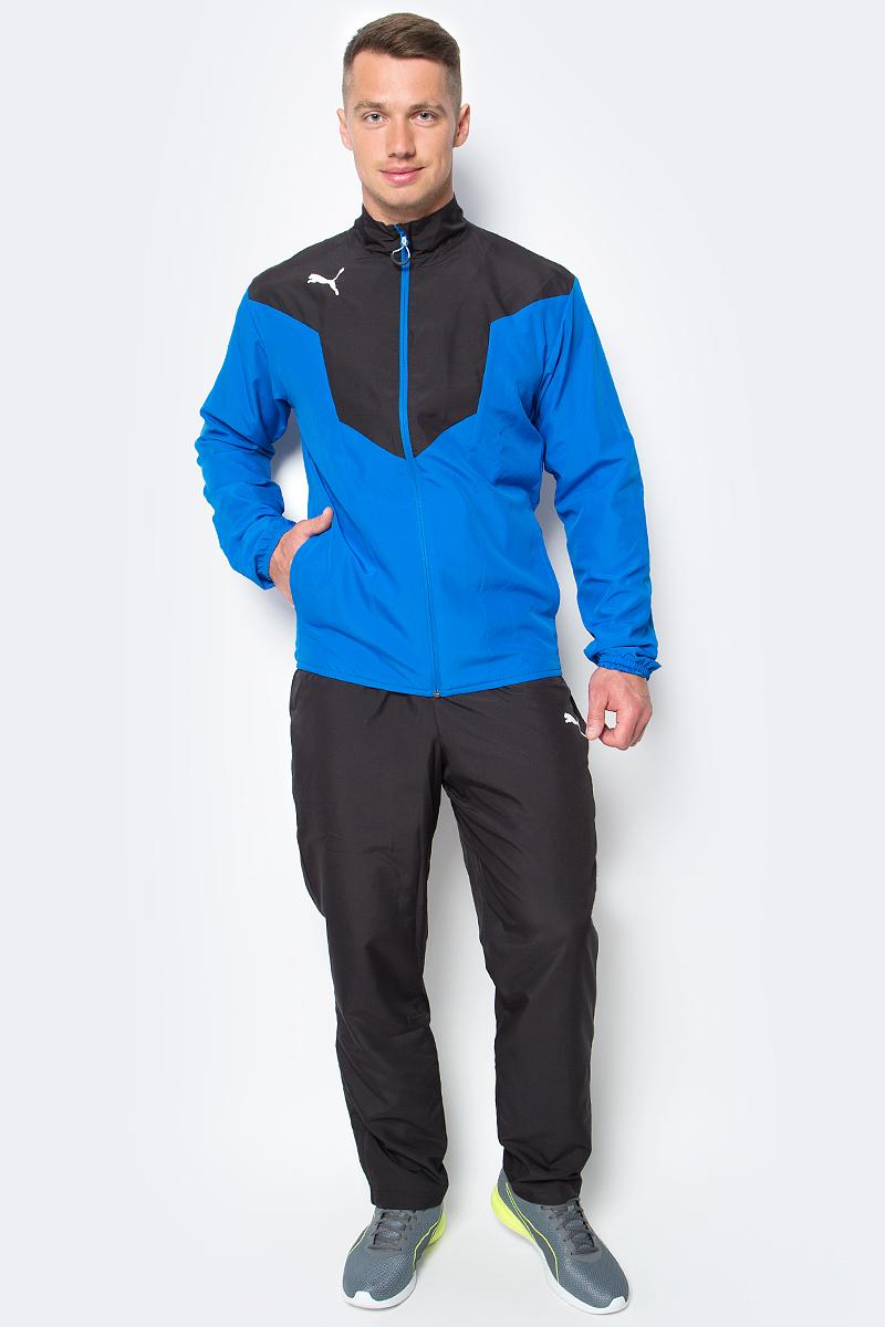 Костюм спортивный мужской Puma ftblTRG Woven Tracksuit, цвет: голубой, темно-синий. 65520023. Размер M (48/50)65520023Двухцветный спортивный костюм ftblTRG Woven Tracksuit идеален для занятий спортом и прогулок на свежем воздухе. Костюм выполнен из прочного и долговечного полиэстера и снабжен подкладкой. Куртка застегивается на молнию, имеет воротник-стойку, длинные рукава и боковые карманы. Манжеты рукавов и низ куртки отделаны резинкой. Брюки снабжены поясом из эластичного материала и боковыми прорезными карманами. По низу штанин вшиты застежки-молнии. Куртка декорирована логотипом PUMA, а также контрастными вставками. Брюки также декорированы логотипом PUMA. Куртка и брюки имеют стандартную посадку.
