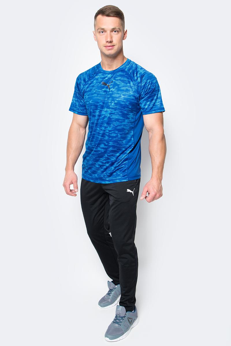 Брюки спортивные мужские Puma ftblTRG Training Pants, цвет: черный. 65520403. Размер L (50/52)65520403Мужские спортивные брюки ftblTRG Training Pants для занятий футболом или любым другим видом спорта отлично подойдут для носки во время тренировок и отдыха. Модель изготовлена из полиэстера с использованием высокофункциональной технологии dryCELL, которая отводит влагу, поддерживает тело сухим и гарантирует комфорт. Пояс из эластичного материала снабжен затягивающимся шнуром. Изделие имеет стандартную посадку и сетчатые вставки. Брюки декорированы логотипом PUMA.