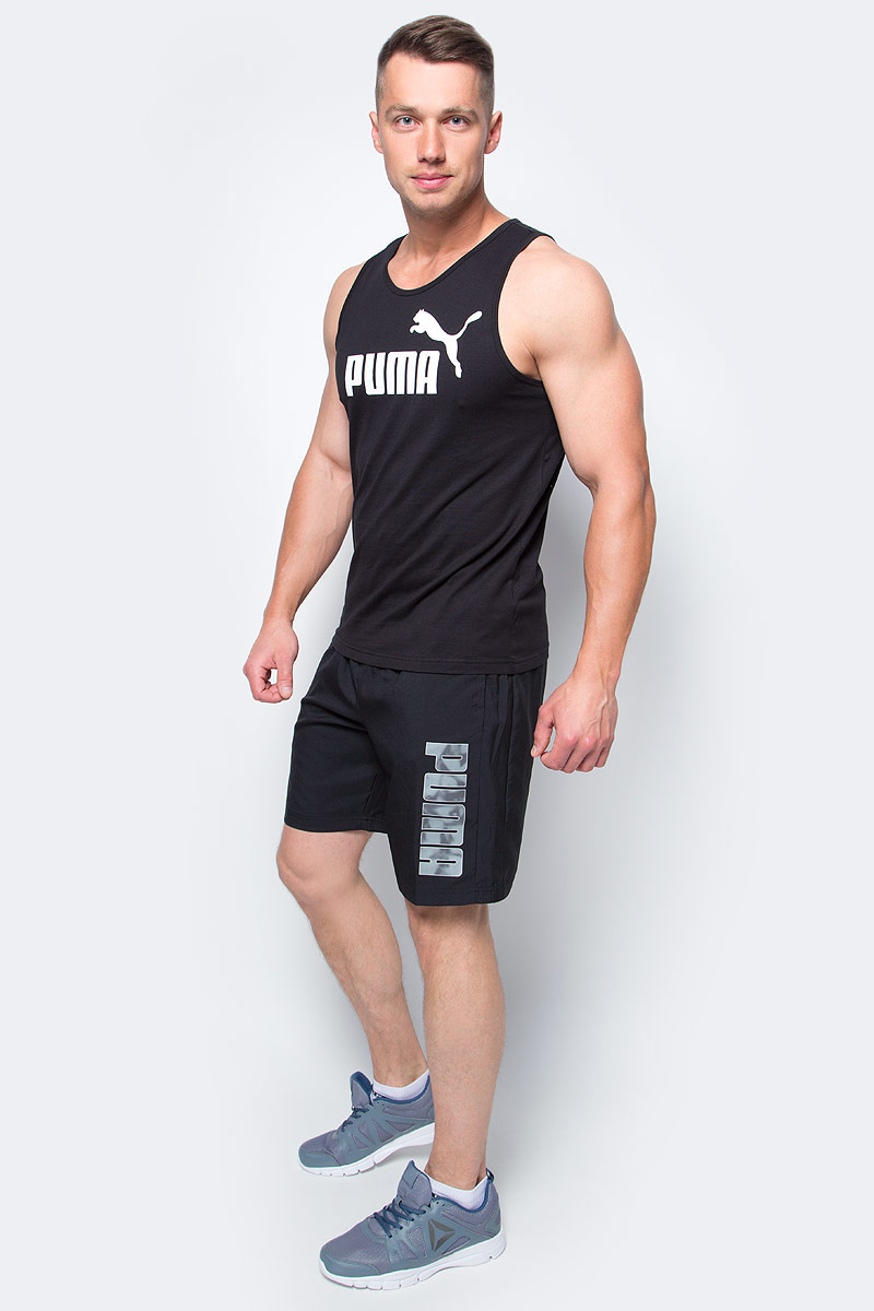 Шорты мужские Puma Hero Woven Shorts, цвет: черный. 83832731. Размер XXL (52/54)83832731Шорты мужские Hero Woven Shorts выполнены из 100% полиэстера с биопропиткой, которая позволяет выводить влагу наружу, сохранять сухость и комфорт даже при интенсивных нагрузках. Шорты декорированы логотипом PUMA на левой штанине. Среди других особенностей изделия - эластичный пояс с затягивающимся шнуром, боковые карманы в швах, нашитая сверху задняя кокетка для лучшей посадки по фигуре, светоотражающие элементы. Удобные свободные шорты отлично подойдут для занятий спортом и повседневной носки.