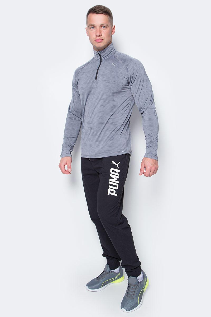 Брюки спортивные мужские Puma Style Tec Woven Pants, цвет: черный. 59103501. Размер M (46/48)59103501Мужские спортивные брюки Style Tec Woven Pants выполнены из нейлона с добавлением эластана. Легкий и прекрасно растягивающийся материал изделия обеспечивает комфорт. Брюки посажены на пояс из эластичного материала с затягивающимся шнуром. Изделие имеет стандартную посадку с чуть заниженной талией. В боковых швах имеются карманы. Сами швы выполнены с нахлестом вперед. Сзади изделие посажено на кокетку. Также сзади имеется накладной карман. Манжеты по низу штанин выполнены из эластичного трикотажа. Брюки декорированы объемными прорезиненными логотипами PUMA спереди наверху на правой штанине и сзади внизу на левой штанине.