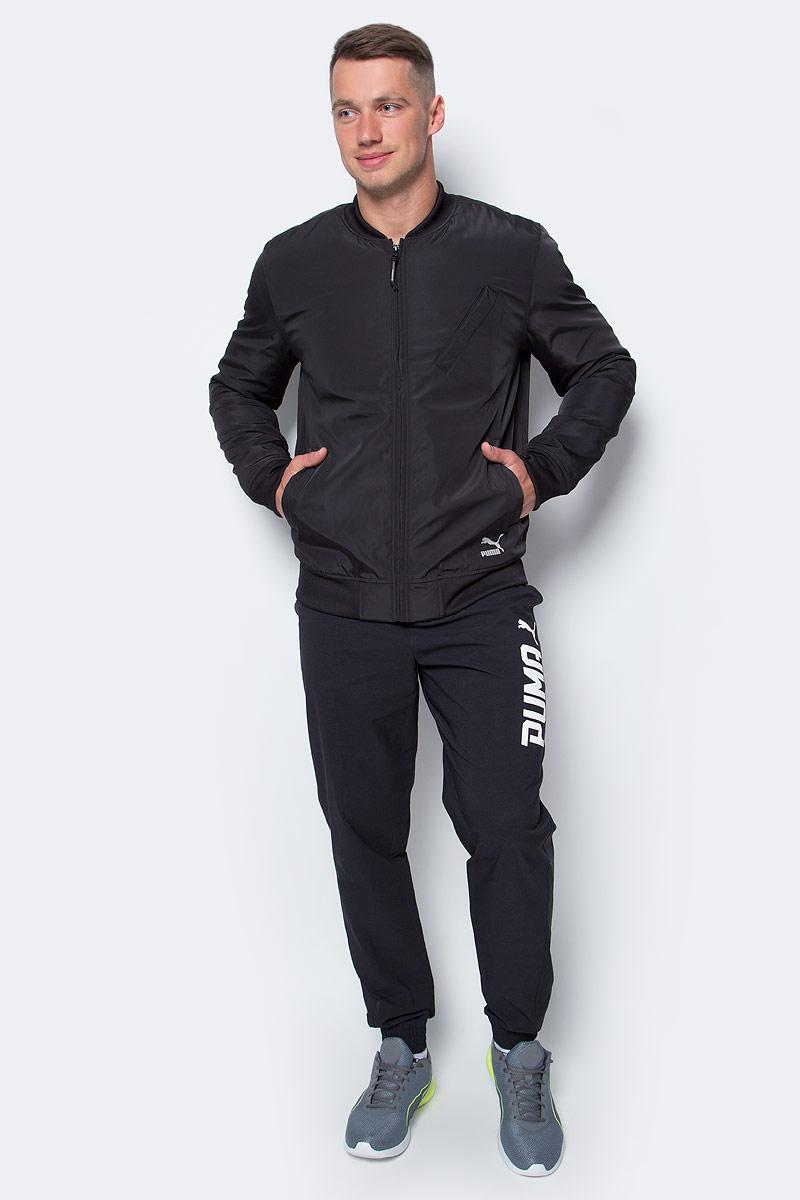 Куртка мужская Puma Evo Core Bomber, цвет: черный. 57162601. Размер L (50)571626_01Куртка создана для повседневной носки, но высокотехнологичные детали, созданные для активного отдыха, добавляют ей спортивного шика. Модель декорирована логотипом Puma из светоотражающего материала и графическим рисунком из светоотражающего материала сзади. Карманы спереди имеют застежки-молнии. Изделие, включая его рукава, посажено на стеганую подкладку. Манжеты, воротник и пояс отделы плосковязаным плотным трикотажем в резинку. Изделие изготовлено из водоотталкивающего материала.