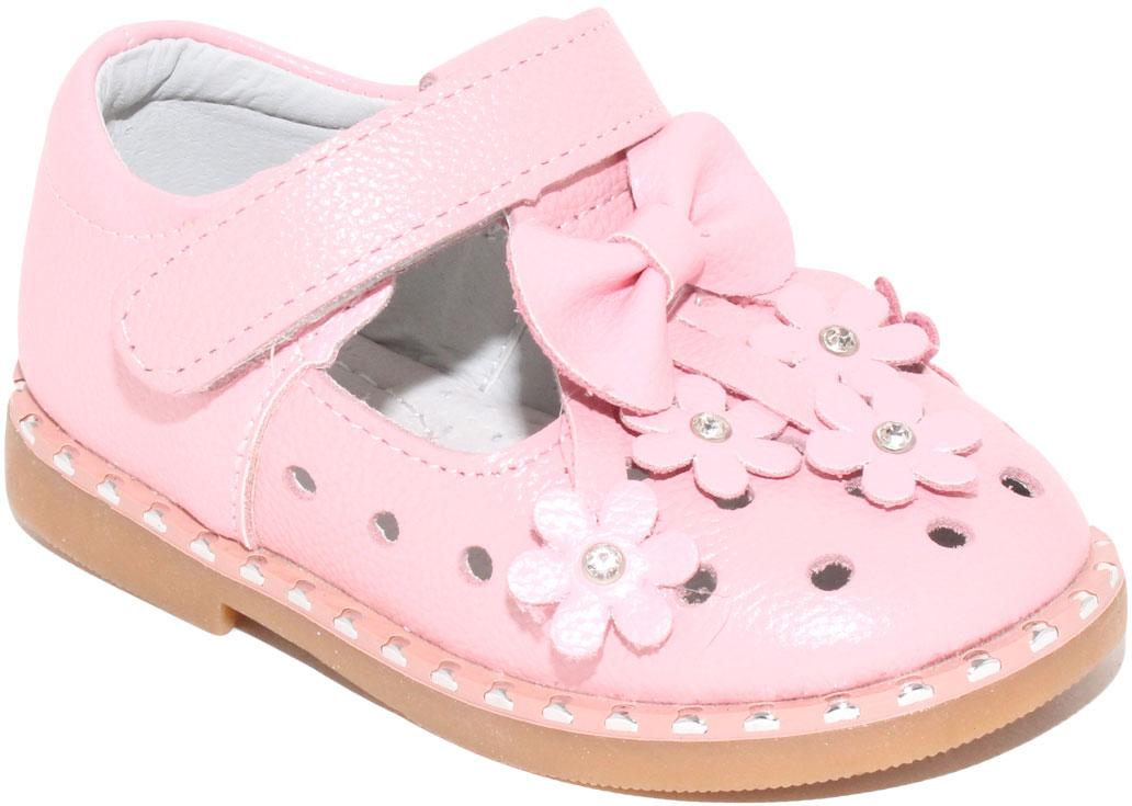 Туфли для девочки Капитошка, цвет: розовый. C7890. Размер 23C7890Стильные туфли для девочки от бренда Капитошка изготовлены из натуральной кожи. Модель оформлена декоративной перфорацией, аппликацией в виде цветочков и бантом на мысе. Туфли имеют ремешок с застежкой-липучкой, который надежно фиксирует обувь на ноге. Стелька, изготовленная из натуральной кожи, гарантирует дополнительный комфорт и предотвращает натирание. Подошва из термопластичной резины оснащена рифлением для лучшего сцепления с поверхностью. Модные туфли займут достойное место в гардеробе вашей девочки.