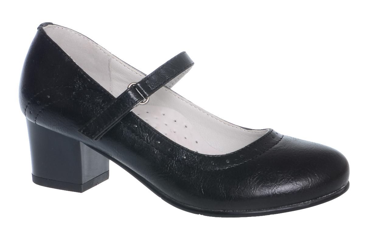 Туфли для девочки Болеро, цвет: черный. D13373. Размер 33D13373Очаровательные туфли для девочки Болеро станут неотъемлемой частью повседневной жизни юной модницы.Модель выполнена из высококачественной искусственной кожи и оформлена перфорацией. Внутренняя отделка выполнена из натуральной кожи. Удобная застежка-липучка быстро и надежно фиксирует обувь на ноге ребенка, а формованный задник обеспечивает правильную установку стопы внутри туфель, предотвращая развитие деформаций.Стелька с супинатором, изготовленная из натуральной кожи, учитывает анатомические особенности строения детской стопы, обеспечивает профилактику от развития плоскостопия и гарантирует ногам ребенка ощущение комфорта и легкости при ходьбе.Рифленая подошва с каблучком из легкого полимерного термопластичного материала обладает высокой прочностью и гибкостью и обеспечивает надежное сцепление с различными поверхностями.
