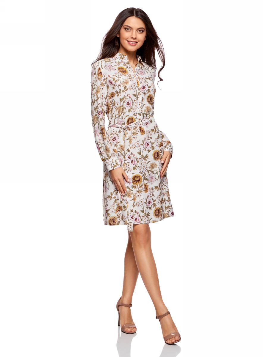 Платье oodji Collection, цвет: кремовый, желтый. 21911022/42800/3052F. Размер 36-170 (42-170)21911022/42800/3052FПлатье-рубашка от oodji выполнено из натуральной вискозы. Модель с длинными рукавами, карманами и отложным воротником застегивается на пуговицы. На талии платье дополнено текстильным поясом.