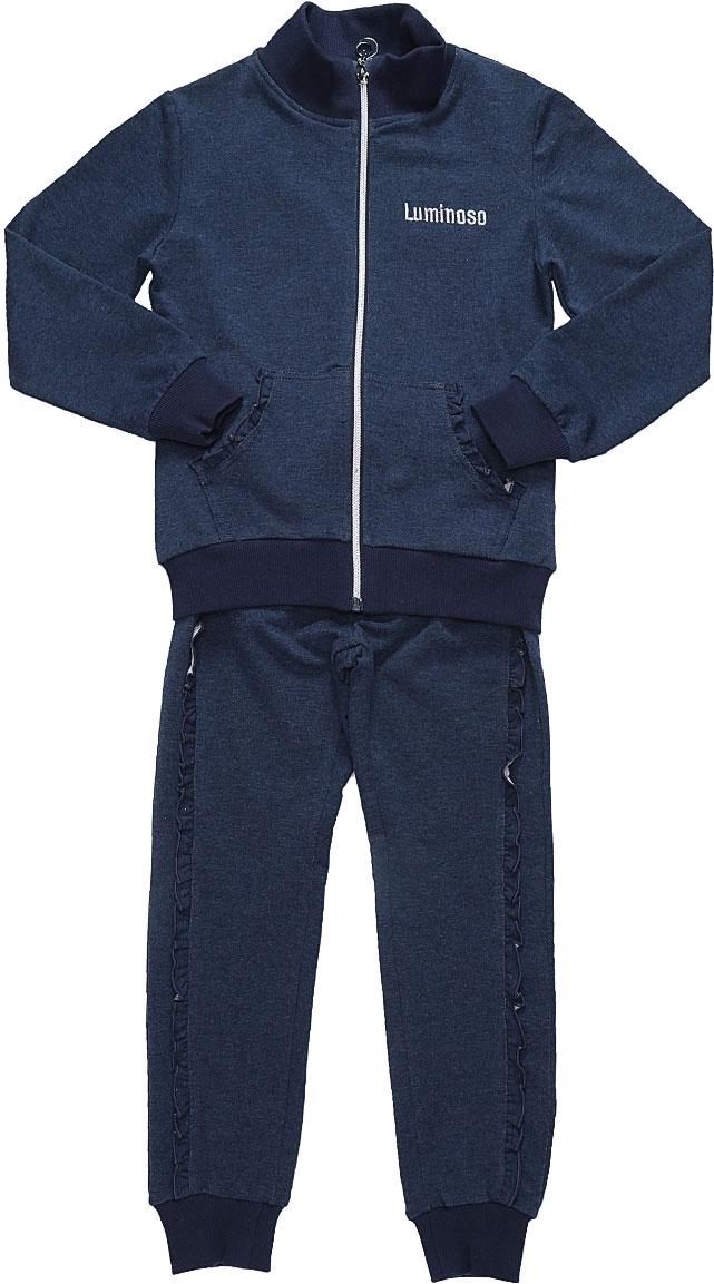 Спортивный костюм для девочки Luminoso, цвет: темно-синий. 728266. Размер 146728266Спортивный костюм для девочки Luminoso состоит из куртки и брюк. Изделия выполнены из эластичного хлопка. Куртка имеет длинные рукава, воротник-стойку и застежку на молнию. Спереди расположены два кармана-кенгуру. Брюки имеют широкую резинку на талии и шнурок для регулировки посадки, а также боковые втачные карманы. Манжеты рукавов, воротник, низ куртки и брючины отделаны эластичной резинкой. Карманы куртки и брюки дополнены рюшами.