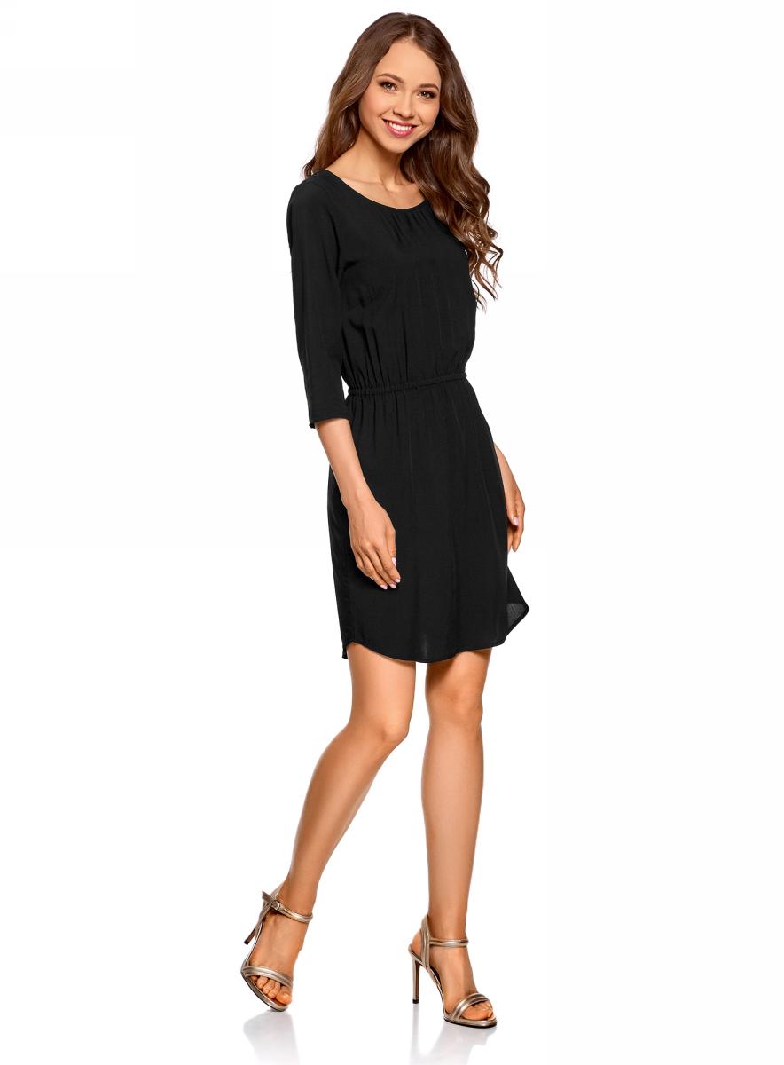 Платье oodji Ultra, цвет: черный. 11901153-1B/42540/2900N. Размер 34 (40-170)11901153-1B/42540/2900NПлатье oodji изготовлено из качественного материала. Модель выполнена с рукавами 3/4 и круглым вырезом горловины. Платье-миди на талии собрано на внутреннюю резинку.