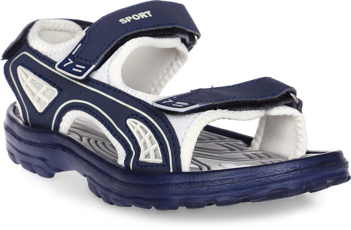 Сандалии для мальчика Эмальто, цвет: темно-синий. 8669В. Размер 328669ВМодные сандалии для мальчика от Эмальто выполнены из легкого синтетического материала. Верхняя поверхность подошвы дополнена рельефом, который обладает массажными свойствами. Ремешки с застежками-липучками надежно зафиксируют модель на ноге. Модель оформлена декоративной прострочкой и надписями. Подошва дополнена рифлением. Легкие и удобные сандалии займут достойное место в летнем гардеробе вашего ребенка.