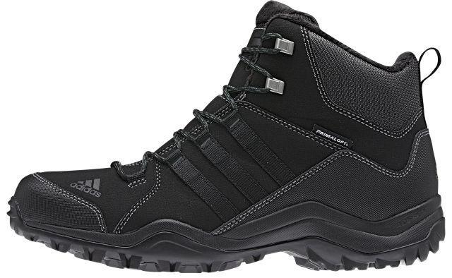 Ботинки трекинговые муж Adidas Winter Hiker Ii Cp Pl, цвет: черный, серый. M18836. Размер 11,5 (45)M18836Winter Hiker II CP PL займут достойное место в вашем гардеробе. Модель выполнена из комбинации прочного сетчатого текстиля, искусственной кожи и других искусственных материалов. Верх изделия оформлен шнуровкой, которая надежно фиксирует обувь на ноге. Ботинки с закругленным мыском внутри выполнены из текстиля с верхней частью из искусственного меха. Утеплитель Primaloft предназначен для максимального тепла, защиты от влаги и комфорта. Стелька исполнена из текстиля. По бокам обувь декорирована тремя фирменными полосками, а на заднике и мыске тиснением в виде логотипа бренда. Уникальный дизайн в сочетании с технологией Adiprene, в промежуточной части подошвы, служит для дополнительной амортизации и смягчения ударных нагрузок. Задняя часть кроссовок дополнена ярлычком для более удобного надевания обуви. Подошва с рельефом Traxion, изготовленная из гибкой резины, обеспечит прочное сцепление с любой поверхностью.