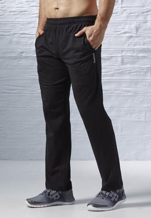 Брюки спортивные мужские Reebok El Jers Oh Pant, цвет: черный. AJ3106. Размер M (48/50)AJ3106Спортивные мужские брюки Reebok выполнены из натурального хлопка. Модель дополнена по боком двумя прорезными карманами и одним карманом сзади. Эластичный пояс и контрастный внутренний шнурок, обеспечат оптимальную посадку. Модель дополнена вышитым логотипом бренда.