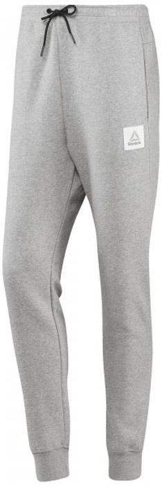 Брюки спортивные мужские Reebok Cs Jogger Pant, цвет: серый. BP8552. Размер M (48/50)BP8552Спортивные мужские брюки Reebok выполнены из натурального хлопка с добавлением полиэстера. Модель дополнена по боком прорезными карманами. Эластичный пояс на шнурке и манжеты на лодыжках, обеспечат оптимальную посадку. Модель дополнена логотипом бренда.