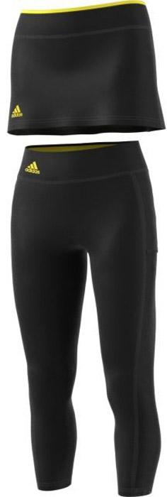 Юбка-тайтсы 2 в 1 для тенниса женская Adidas Us Series Leg, цвет: черный. BP9394. Размер XS (40/42)BP9394Женская юбка - тайтсы Adidas выполнена из высококачественного материала. Леггинсы укороченной длины,дополнены сетчатыми вставками по бокам,для повышенной вентиляции. Юбка украшена контрастной вставкой по верхнему краю пояса. Эластичный тонкий трикотаж, облегающий крой и широкий пояс подчеркивают изящность фигуры. Технология climacool® эффективно отводит излишки влаги, сохраняя чувство свежести на протяжении всего дня.