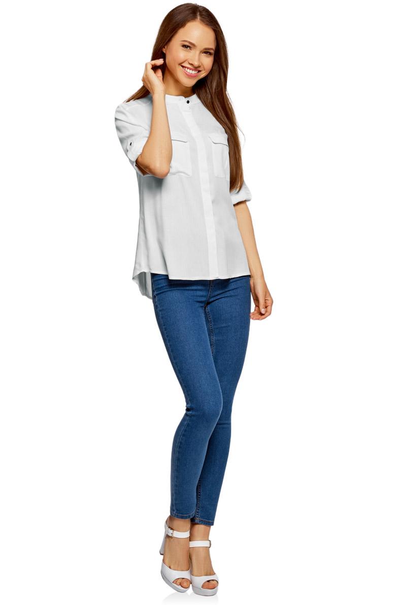 Блузка женская oodji Ultra, цвет: белый. 11403225-2B/26346/1200N. Размер 36-170 (42-170)11403225-2B/26346/1200NМодная женская блузка oodji изготовлена из качественной вискозы и застегивается на пуговицы. Модель выполнена с рукавами 3/4, дополненными специальной шлевкой для подгиба. Передняя часть оформлена накладными карманами под клапанами.