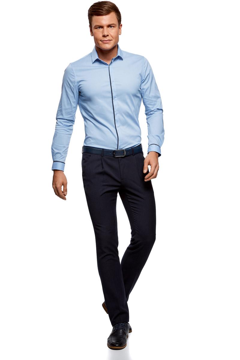 Рубашка мужская oodji Basic, цвет: голубой, темно-синий. 3B140005M/34146N/7079B. Размер 38-182 (44-182)3B140005M/34146N/7079BМужская рубашка oodji с длинными рукавами изготовлена из качественной смесовой ткани. Рубашка застегивается на пуговицы в планке, манжеты рукавов дополнены застежками-пуговицами.