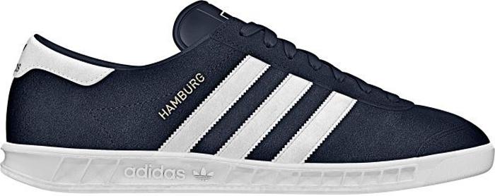 Кроссовки мужские Adidas Hamburg, цвет: темно-синий, белый. S74838. Размер 10,5 (44)S74838Кроссовки мужские Adidas Hamburg выполнены из премиальной зернистой кожи и оформлены тремя фирменными кожаными полосками. Дышащая сетчатая подкладка обеспечивает комфорт при движении. Шнурки надежно зафиксируют модель на ноге. Классическая подошва исполнена из натуральной резины. Поверхность подошвы дополнена рельефным рисунком для идеального сцепления.