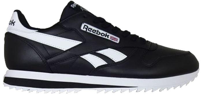 Кроссовки мужские Reebok Cl Leather Ripple L, цвет: черный, белый. BS8298. Размер 8 (40,5)BS8298Классический стиль кроссовок Reebok Cl Leather Ripple L позволит вам выглядеть уместно в любой ситуации. Логотипы сзади и сбоку придадут образу легкий налет ретро, а прочная подошва гарантирует отличное сцепление с любой поверхностью. Особенности: Мягкий замшевый верх с кожаными вставками для комфорта и надежной поддержки.Низкий дизайн гарантирует полную свободу движений.Литая промежуточная подошва из ЭВА эффективно поглощает энергию удара.Стойкая к истиранию, прочная резиновая подошва обеспечивает отличное сцепление с любой поверхностью.Формованная стелька из пеноматериала для амортизации и дополнительного комфорта.