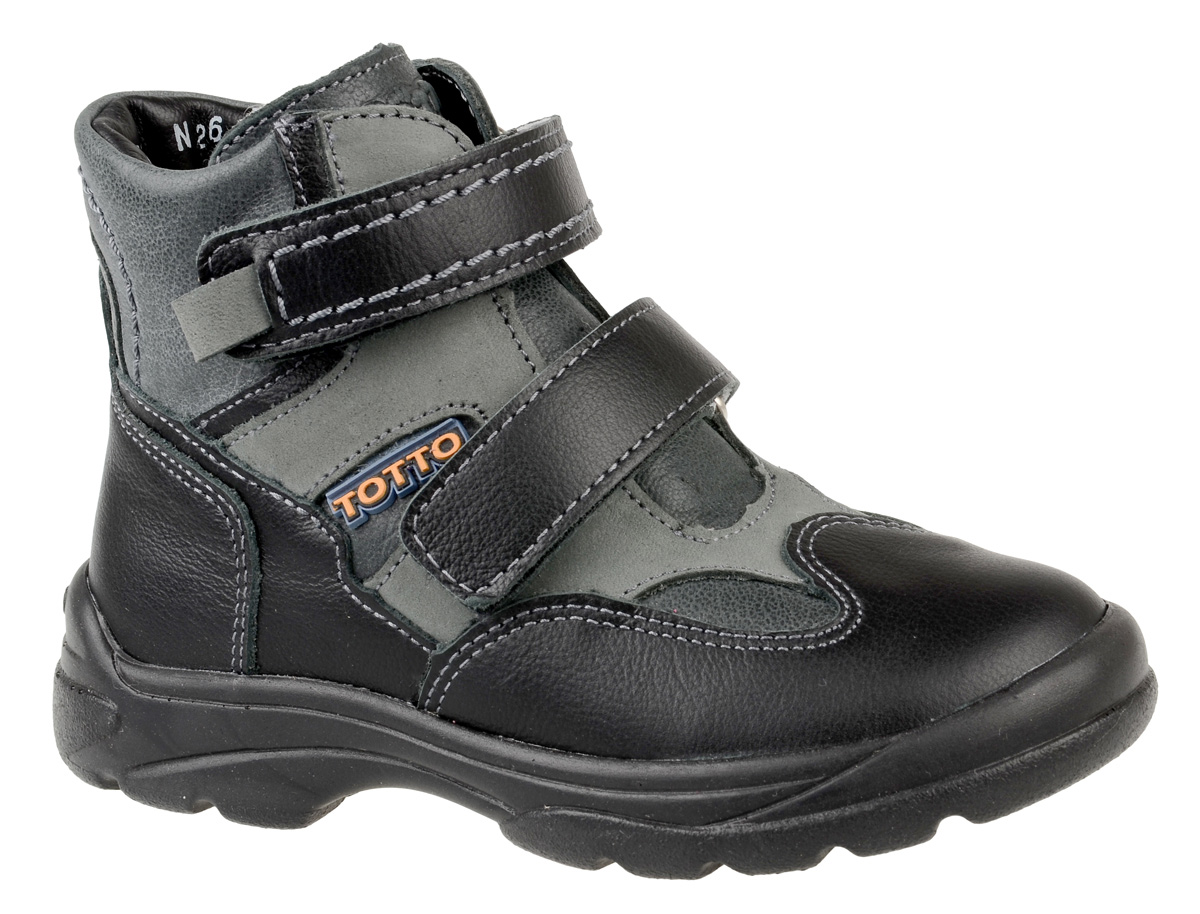 Ботинки для мальчика Тотто, цвет: черный, серый. 211-БП. Размер 29211-БПБотинки для мальчика Тотто - это ортопедическая обувь, которая помогает правильному формированию стопы ребенка. Такая обувь необходима в детском возрасте для коррекции стоп при плоскостопии и вальгусной деформации, а также для профилактики этих состояний. Она обеспечивает правильное распределение нагрузки на передний отдел стопы и пятку, за счет чего малыш лучше удерживает равновесие и чувствует себя более уверенно. Обувь Тотто идеально подходит для детей, которые только начали ходить.Верх ботинок выполнен из натуральной кожи. Подошва изготовлена из легкого, гибкого и прочного термопластичного материала, она смягчает удары от соприкосновения обуви с поверхностью, защищая детскую ножку от травм. Протектор подошвы обеспечивает надежное сцепление с землей или асфальтом. Внутренняя поверхность и стелька отделаны байкой. Ботинки застегиваются с помощью ремешков на липучки, благодаря которым можно регулировать объем обуви. Весь модельный ряд Тотто характеризует: плотный захват голеностопа, мягкие нейтрализующие швы, жесткий задник продлен до середины стопы, стельки со сводоподдерживающим эффектом, натуральная кожа.
